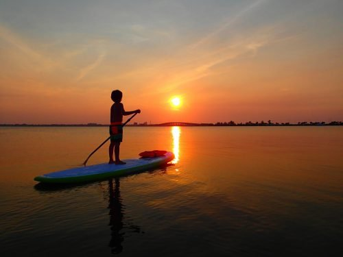 Sunset with paddle boarder on the Indian River Lagoon